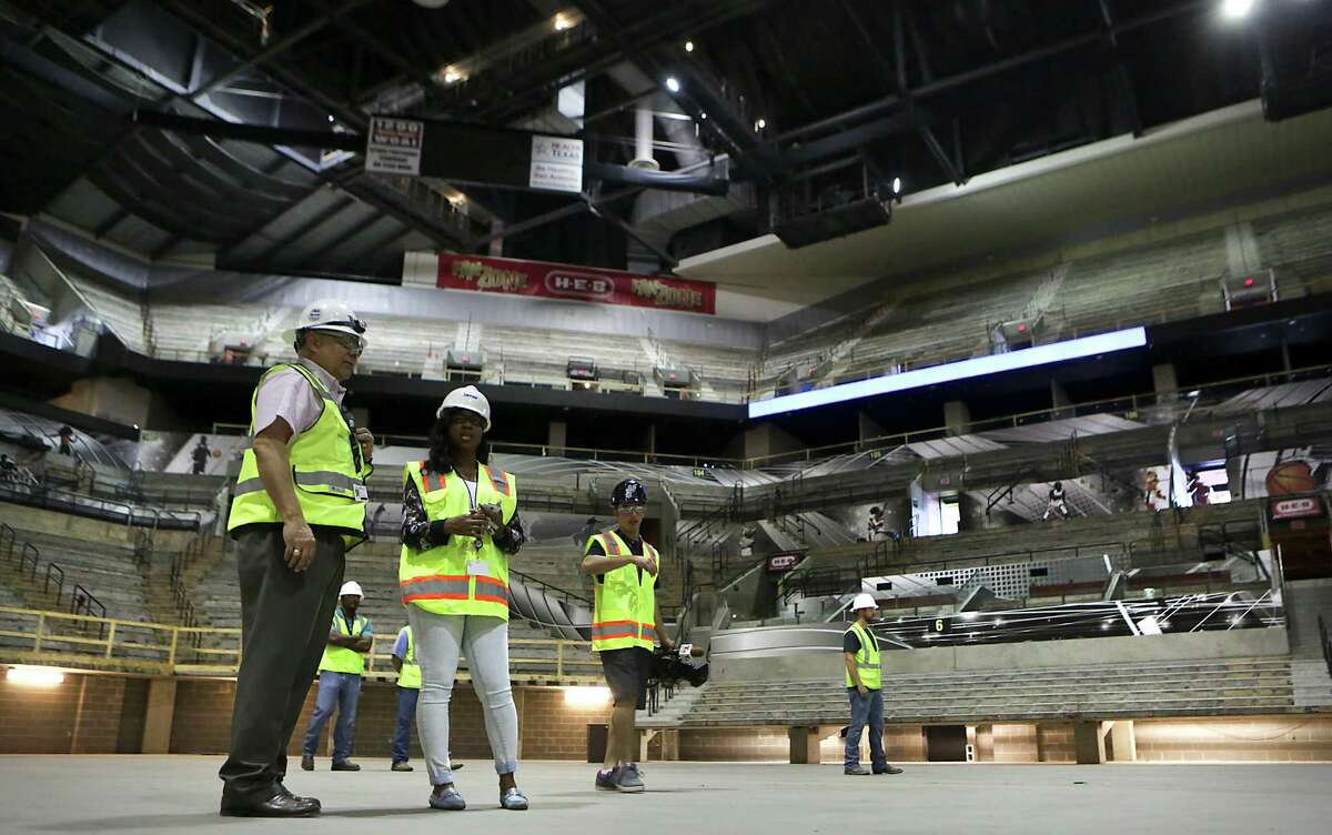 Media and construction personel stand in on the base floor of The AT&T Center on Thursday June 18, 2015, during a tour by the Hunt Construction Group and Spurs representatives. The Spurs home is going through a remodel.