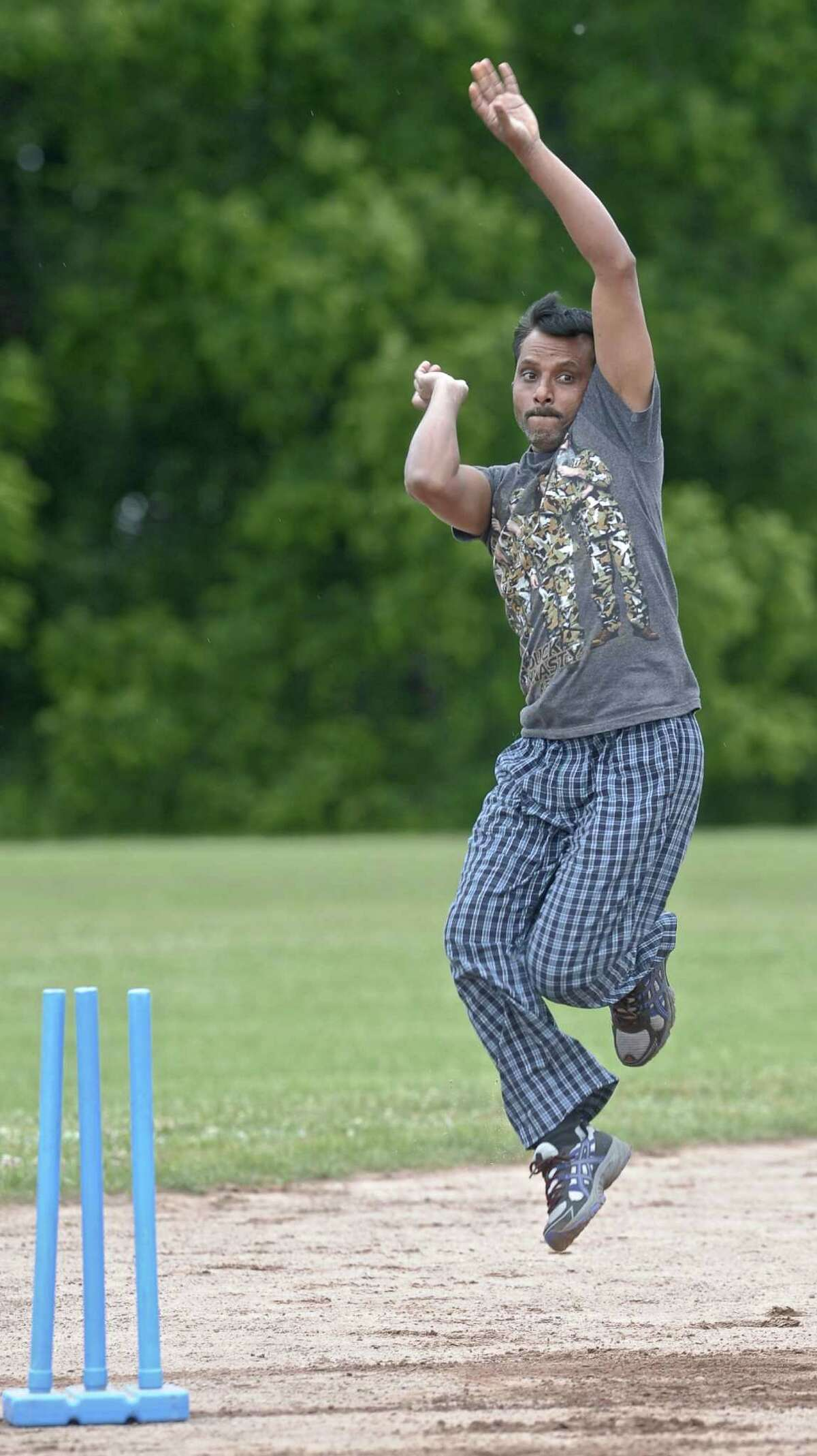 Bowler Mallesh Pittla winds uo to deliver the ball during a Brookside Cricket Club practice.