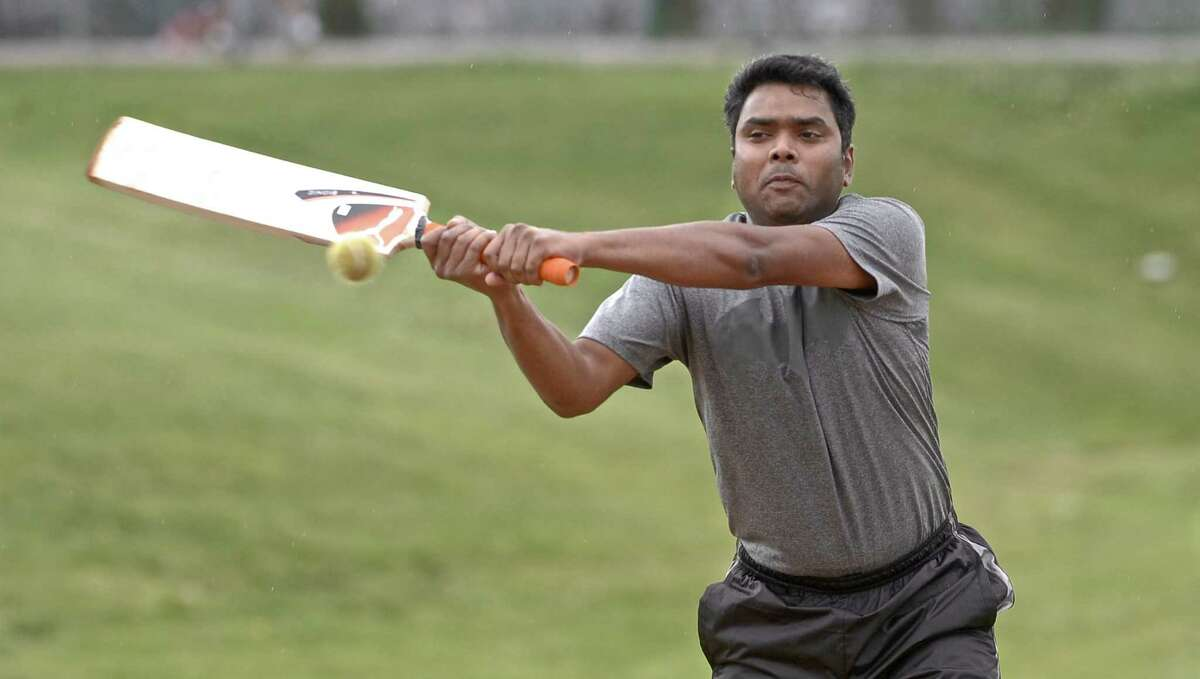 Ram Tudu swings at the ball during a Brookside Cricket Club practice.