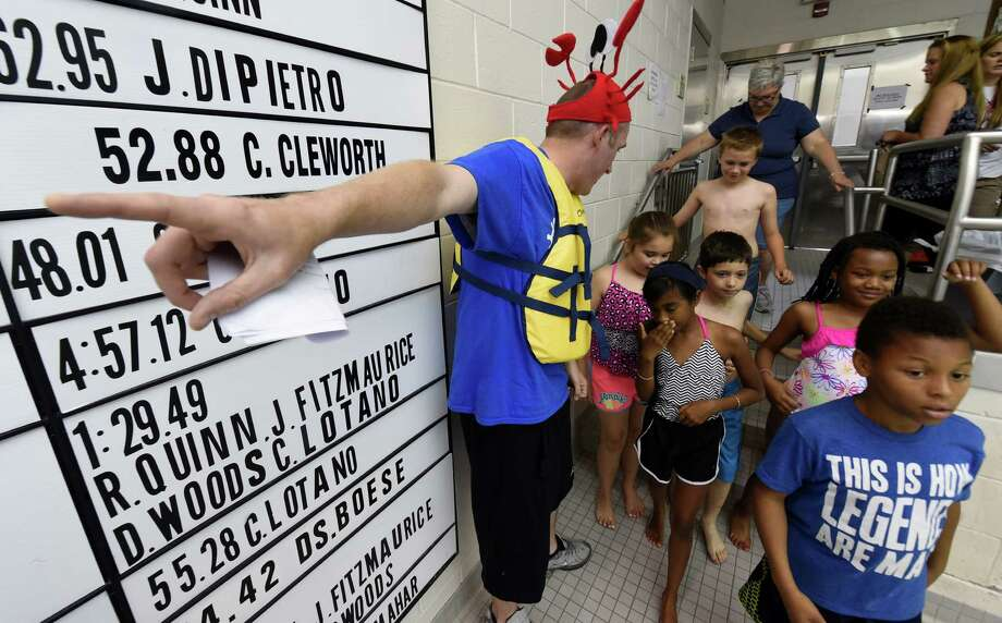 """Fourth graders from Hamilton Elementary School are given directions to their """"Keeping Kids Safe Around Water"""" courses Wednesday morning June 17, 2015, by Ross Jordan, director of ops at East Greenbush Y at the Schenectady High School pool in Schenectady, N.Y.     (Skip Dickstein/Times Union) Photo: SKIP DICKSTEIN / 00032299A"""