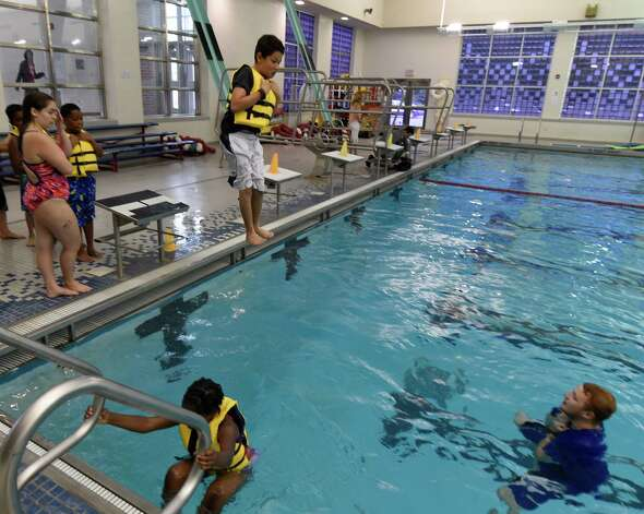 "Fourth graders from Hamilton Elementary School are given instruction on boat safety during their ""Keeping Kids Safe Around Water"" courses Wednesday morning June 17, 2015, by Alex Ranucci, head lifeguard at Southern Saratoga Y, far right,  at the Schenectady High School pool in Schenectady, N.Y.     (Skip Dickstein/Times Union) Photo: SKIP DICKSTEIN / 00032299A"