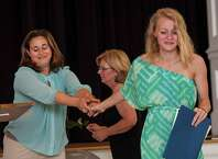 Shelby Curley (right) receives her diploma from teacher Lindsey Pontieri at the Graduation ceremony of the Greenwich Alternative high school held at St Catherine of Siena church in the Riverside section of Greenwich, CT on Thursday, June 18th, 2015.