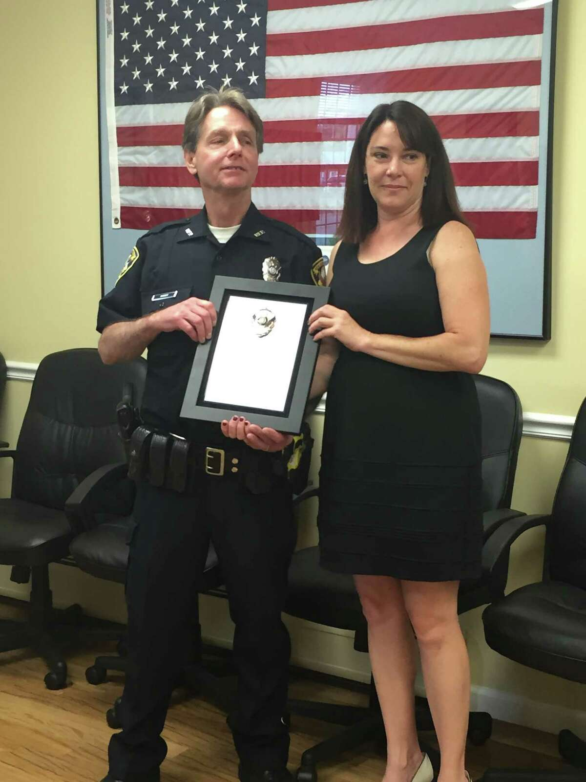 Kevin Casey (left) is presented a plaque by First Selectwoman Susan Chapman for his years of service. Casey is retiring after 35 years with the New Fairfield Police Department.