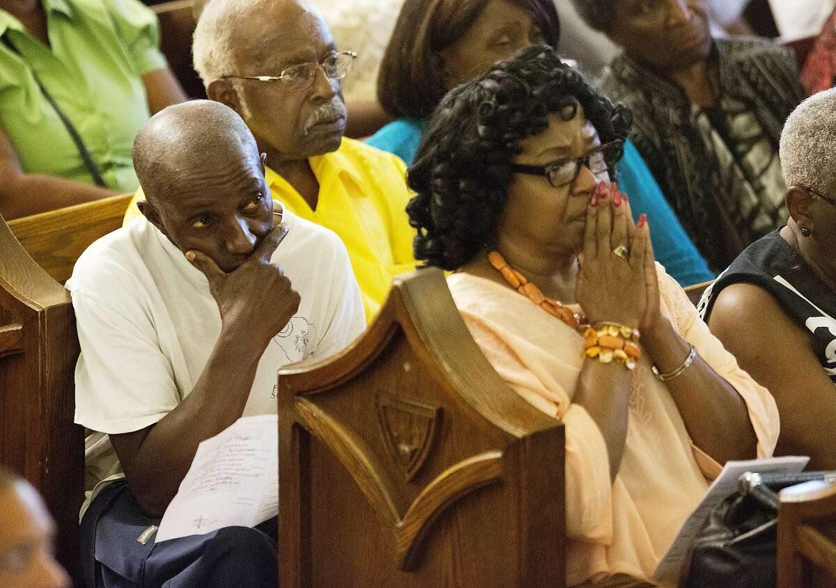 Parishioners listen during a memorial service at Morris Brown AME Church for the nine people killed Wednesday during a prayer meeting inside a historic black church in Charleston, S.C., Thursday, June 18, 2015. (AP Photo/David Goldman)