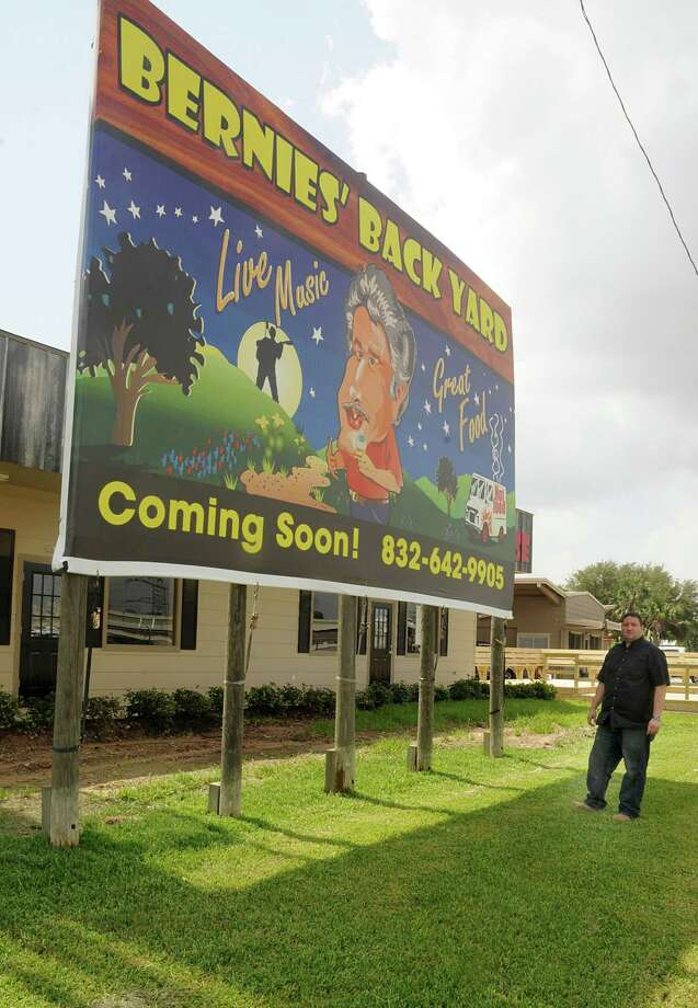 Clark Evans walks past the new Bernie's Backyard billboard at Bernie's Backyard, 22310 I-45 N in Spring, a food truck park that will open soon. Photograph by David Hopper. Photo: David Hopper, Freelance / freelance