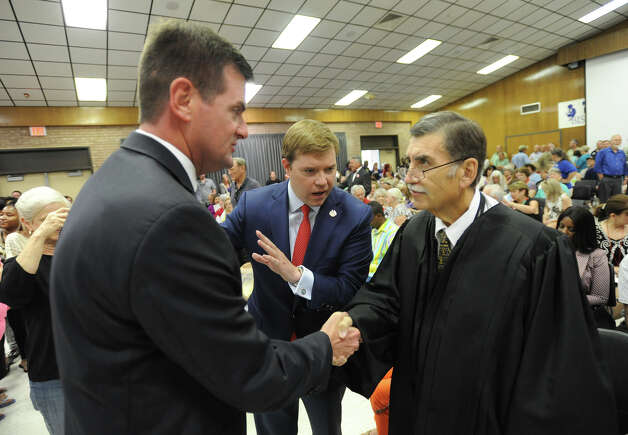 """Cory Crenshaw, then Jefferson Coutny District Attorney, introduces then-candidate for state Senate, Brandon Creighton, left, to Court at-law No. 2 Judge G.R. """"Lupe"""" Flores who officiated at the swearing in of the Beaumont ISD Board of Managers on July 21, 2014.  Crenshaw could be appointed Monday to replace Flores, who died in April.  Photo taken Monday, July 21. 2104 Guiseppe Barranco/@spotnewsshooter Photo: Guiseppe Barranco, Photo Editor"""