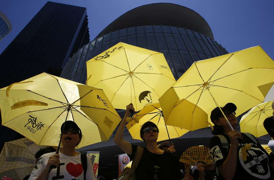 Pro-democracy protesters hold yellow umbrellas during a rally outside the Legislative Council in Hong Kong before Beijing-backed election reforms were defeated by pro-democracy lawmakers. Photo: Kin Cheung, Associated Press