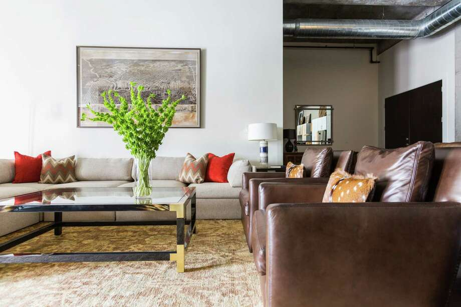 "Designer Laura Umansky warmed up this undustrial-style loft-like space with the warm woods and leathers owner Steve Johnston enjoys. ""You just walk in and sit anywhere and it feels comfortable,"" he says."
