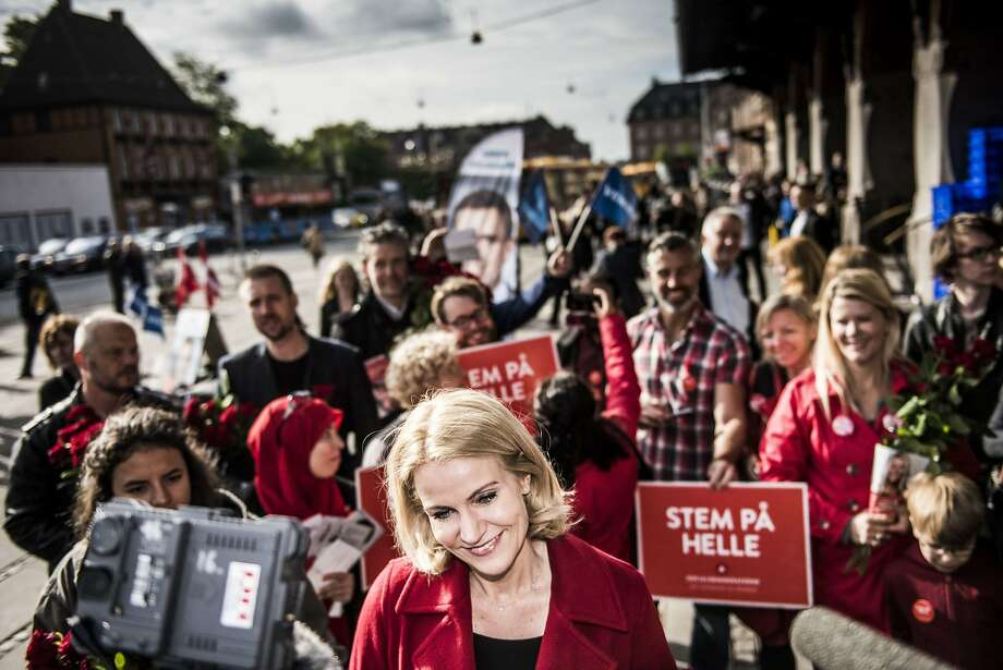 Denmark's Prime Minister Helle Thorning-Schmidt hands out red roses to potential voters at the grand central station in Copenhagen during general elections. Photo: Asger Ladefoged, AFP / Getty Images