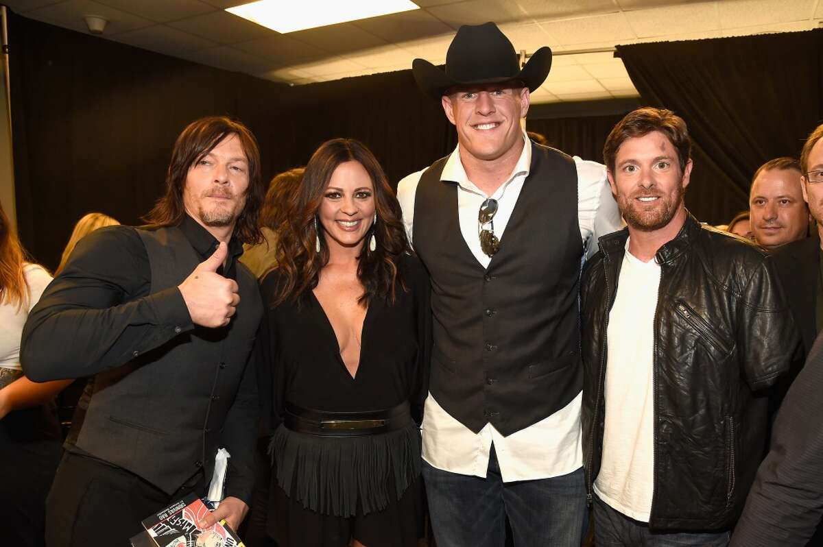 NASHVILLE, TN - JUNE 10: (L-R) Norman Reedus, Sara Evans, J.J. Watt and Noah Galloway attend the 2015 CMT Music awards at the Bridgestone Arena on June 10, 2015 in Nashville, Tennessee. (Photo by Rick Diamond/Getty Images for CMT)