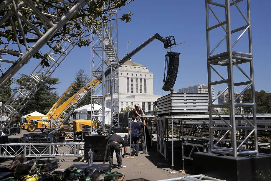 Workers prepare the main stage, on Thurs. June 18, 2015, for the 2015 NBA Champion Golden State Warriors' parade and celebration which ends at the Kaiser Convention Center, in Oakland, Calif. Photo: Michael Macor, The Chronicle