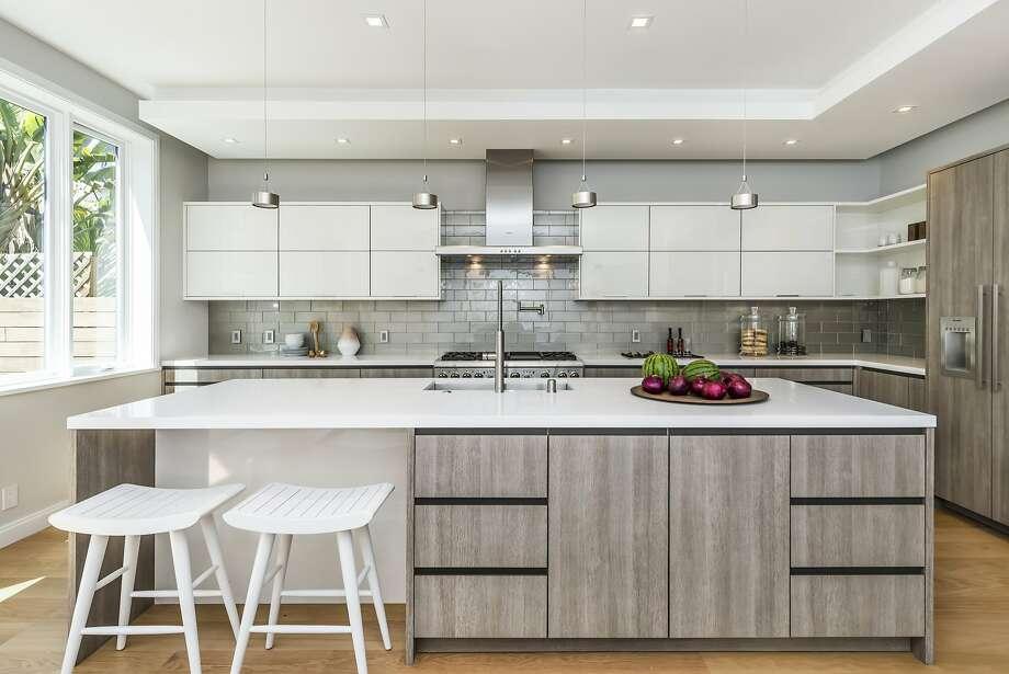 Pendant and recessed lights illuminate the kitchen. Photo: Olga Soboleva/Vanguard Propertie