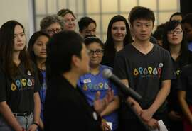 Teen volunteers gaze on while Teresa Ono speaks at the opening of The Mix at the San Francisco Public Library in San Francisco, California, on Thursday, June 18, 2015.