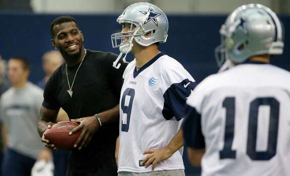 Dallas Cowboys wide receiver Dez Bryant, left, stands on the field with quarterback Tony Romo (9) during an NFL football minicamp at the team's stadium in Arlington, Texas, in Arlington, Texas, Thursday, June 18, 2015. Bryant joined his teammates for the last day of minicamp. Bryant didn't practice Thursday since he still has not signed his franchise tender that would guarantee him $12.8 million this season. Photo: LM Otero /Associated Press / AP