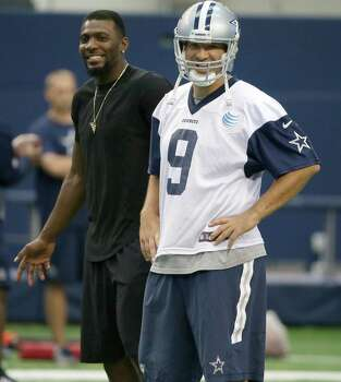 Dallas Cowboys wide receiver Dez Bryant, left, and quarterback Tony Romo (9) laugh as they watch teammates run a drill during an NFL football minicamp at the team's stadium in Arlington, Texas, in Arlington, Texas, Thursday, June 18, 2015. Bryant joined his teammates for the last day of minicamp. Bryant didn't practice Thursday since he still has not signed his franchise tender that would guarantee him $12.8 million this season. Photo: LM Otero /Associated Press / AP
