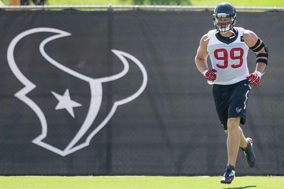 Texans defensive end J.J. Watt jogs onto the practice field.