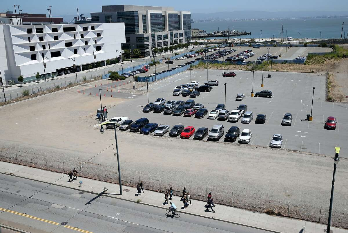 Cars are parked on the Mission Bay site in San Francisco, Calif. on Thursday, June 18, 2015 where the Warriors hope to build a new basketball arena.