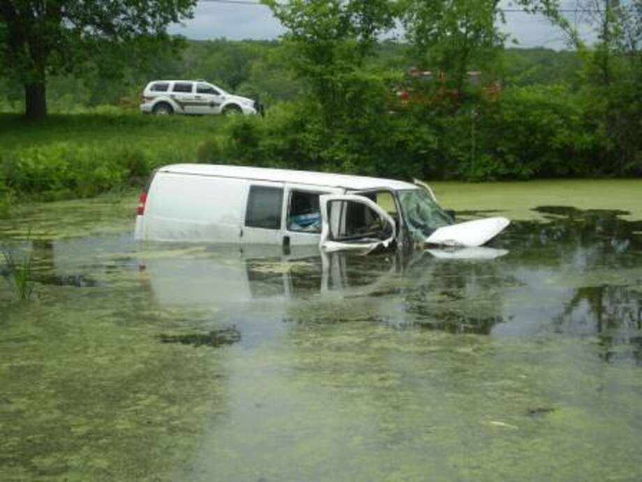 The driver of this van was rescued from the pond in New Scotland Thursday, June 18, 2015. (State Police New Scotland photo)