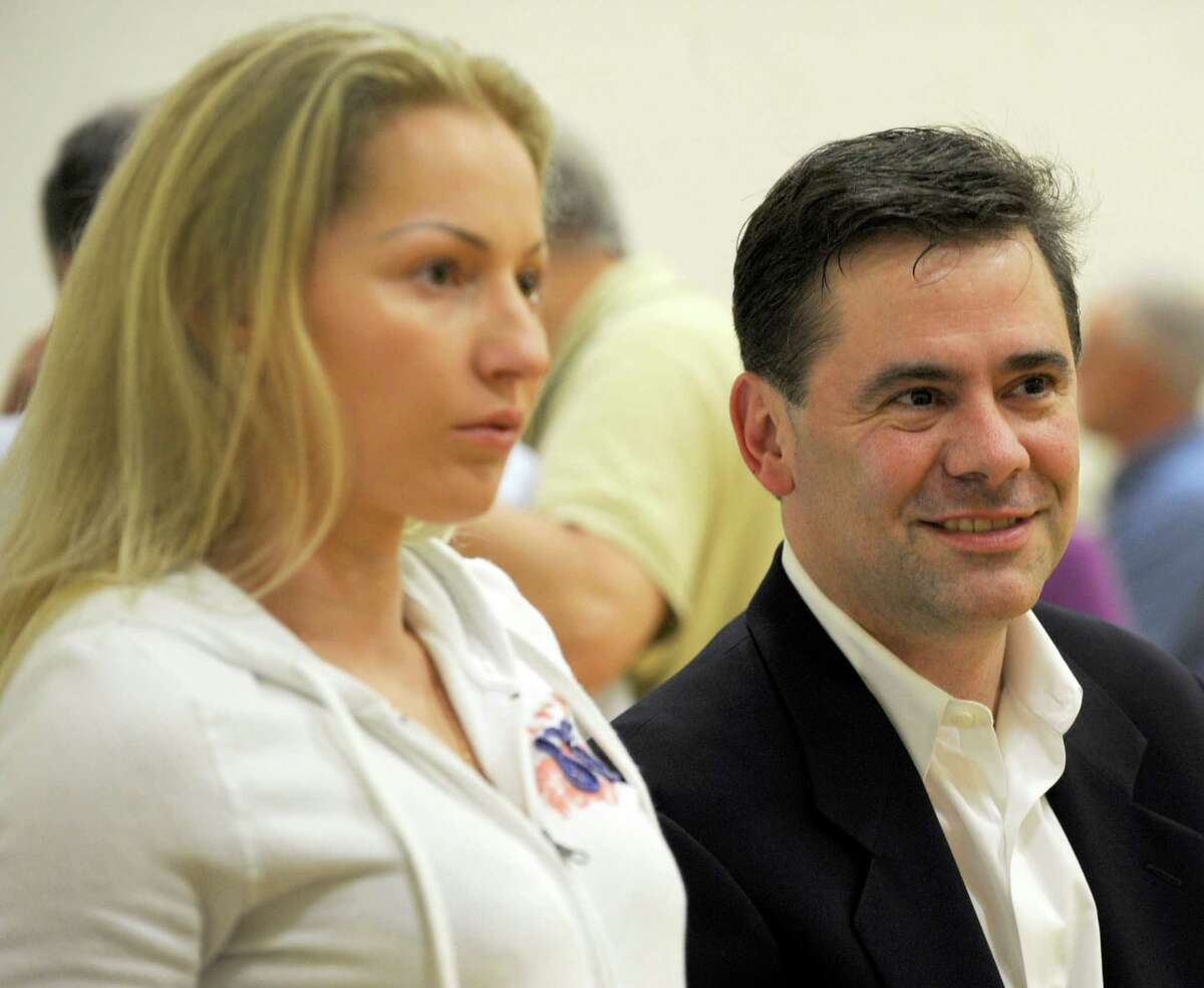 Dasha and Will Duff wait for the votes to be counted at the Hurgin Municipal Center in Bethel, Conn. Tuesday evening, Sept. 10, 2013. The Republicans held a primary Tuesday for the offices of first selectman and selectman.
