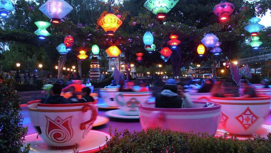 Even at 5:30 a.m., with only an 30 minutes left in Disneyland's 24-hour party, riders are indulging in the park's classic rides, such as the Mad Tea Party. Photo: Spud Hilton / ONLINE_YES