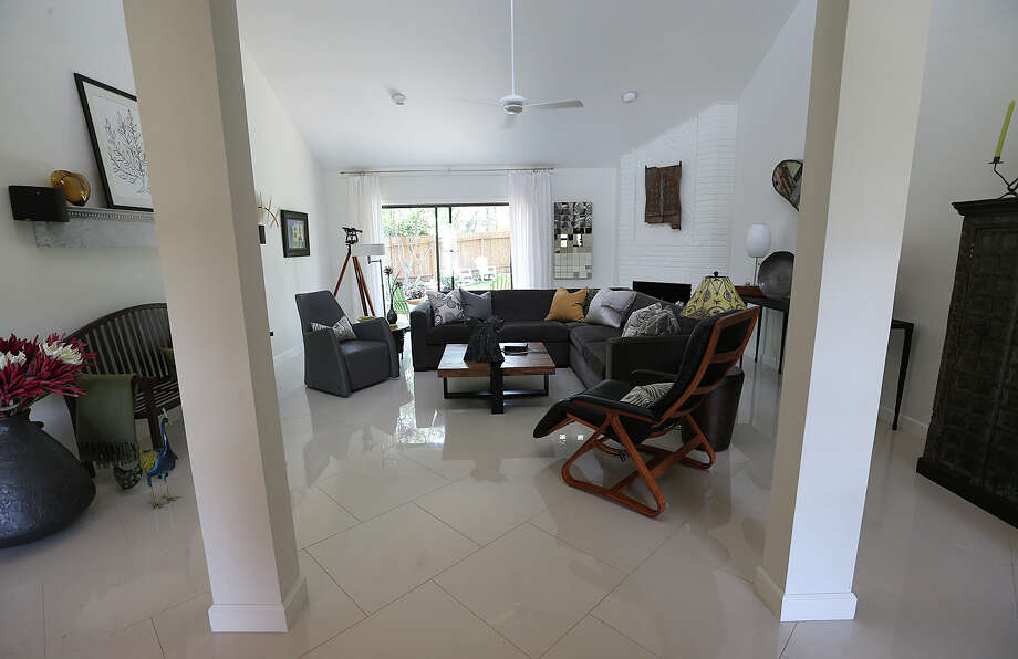 A view of the open living room of the Janet Oglethorpe and Bill Wilke renovated 1980's house in Hunter Creek, Wednesday, June 17, 2015. The couple torn down a wall on the right to create an open space by the entrance to the house. Photo: JERRY LARA, Staff / San Antonio Express-News / © 2015 San Antonio Express-News