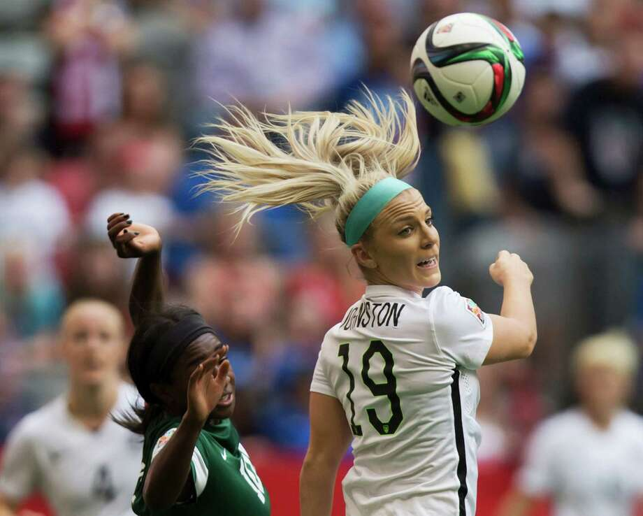 United States' Julie Johnston, right, and Nigeria's Courtney Dike watch the ball during the first half of a FIFA Women's World Cup soccer game Tuesday, June 16, 2105, in Vancouver, British Columbia, Canada. (Darryl Dyck/The Canadian Press via AP) ORG XMIT: VCRD120 Photo: DARRYL DYCK / The Canadian Press