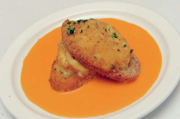 Arancini risotto fritters stuffed with pancetta served over tomato sauce at Rocco's restaurant on Wednesday June 10 2015 in Jonesville, N.Y.  (Michael P. Farrell/Times Union) Photo: Michael P. Farrell / 00032225A