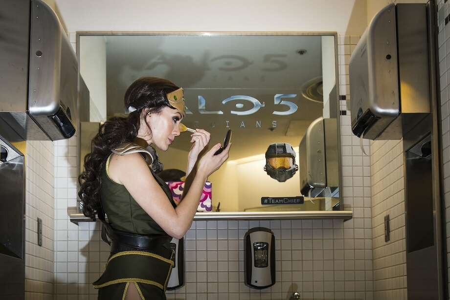 June 16, 2015 - Los Angeles, CA Jennifer Hills, touches up her makeup, as she assumes  the role of a warrior of the ancient world at the E3 2015 convention.   Hills is hired to entice gamers to the DotEmu booth, a French video game company that is bringing Titan Quest to iOS.   E3, is the world's premier trade show for computer, video and mobile games and related products, is being held in downtown Los Angeles.  (Nancy Pastor for the SF Chronicle) Photo: Nancy Pastor