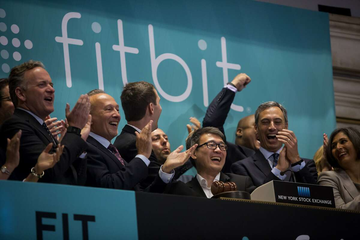 NEW YORK, NY - JUNE 18: Fitbit Chief Executive James Park (C) rings the bell for the company's IPO debut at the New York Stock Exchange on June 18, 2015 in New York City. Fitbit Inc. opened 52% above their IPO price during its market debut. (Photo by Eric Thayer/Getty Images)