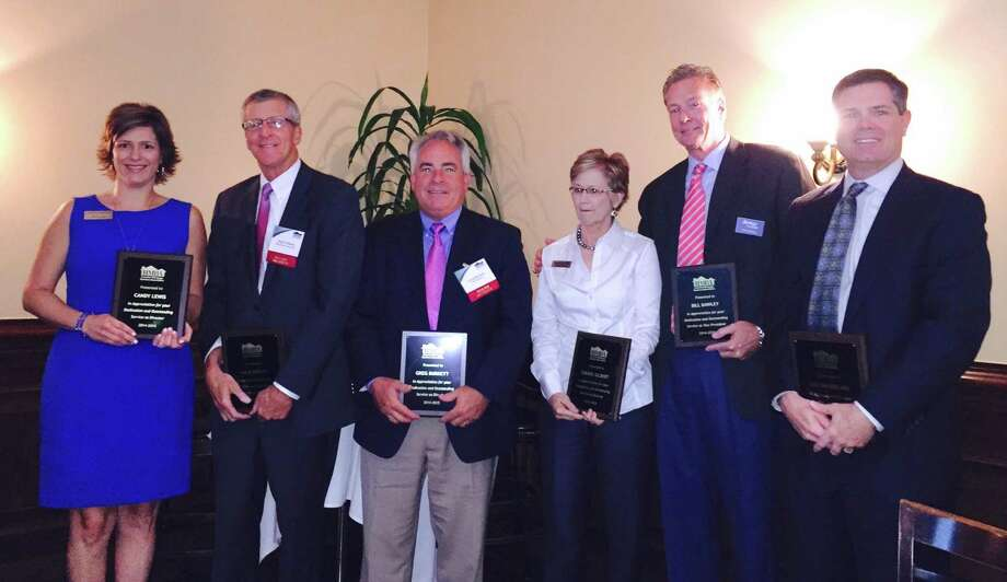 At the luncheon were, from left, directors Candy Lewis and Mack Gibson, vice president Greg Burkett, secretary Sheree Gilbert, president Bill Dawley, and past president Mike McFarland.