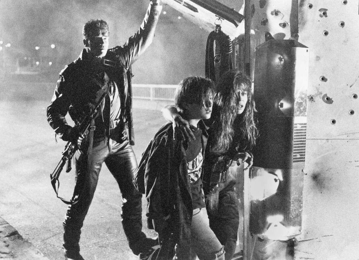 """Arnold Schwarzenegger, Edward Furlong and Linda Hamilton co-star in """"Terminator 2,"""" a 1991 film by James Cameron."""