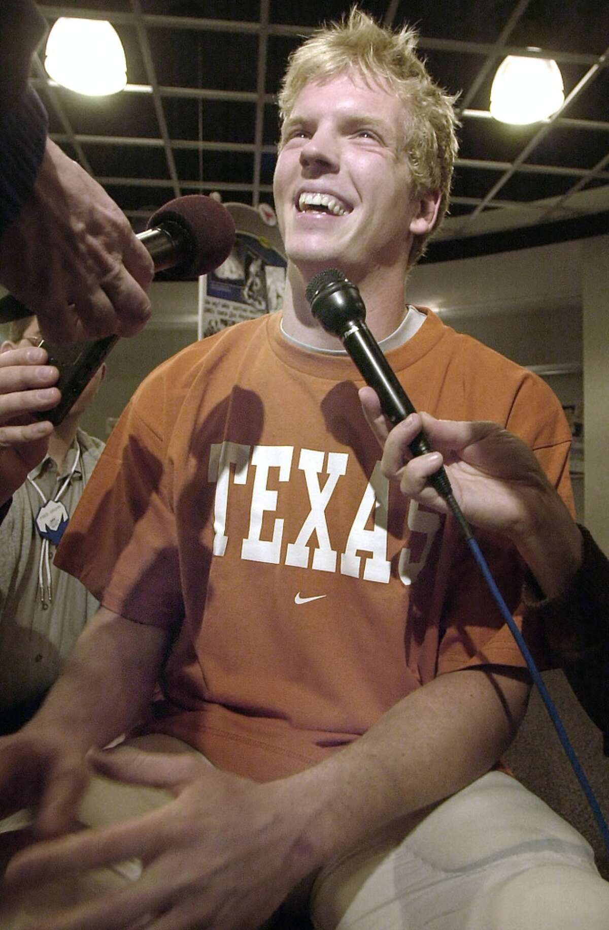 Texas quarterback Chris Simms smiles while speaking to reporters during Cotton Bowl media day in Dallas, Thursday, Dec. 26, 2002. Texas faces LSU in the Jan. 1 bowl game. (AP Photo/LM Otero) HOUCHRON CAPTION (08/26/2003-2-STAR)(08/26/2003): After a successful but very scrutinized career as Texas' quarterback, Chris Simms is enjoying a low key transition to the NFL with the Tampa Bay Bucs.