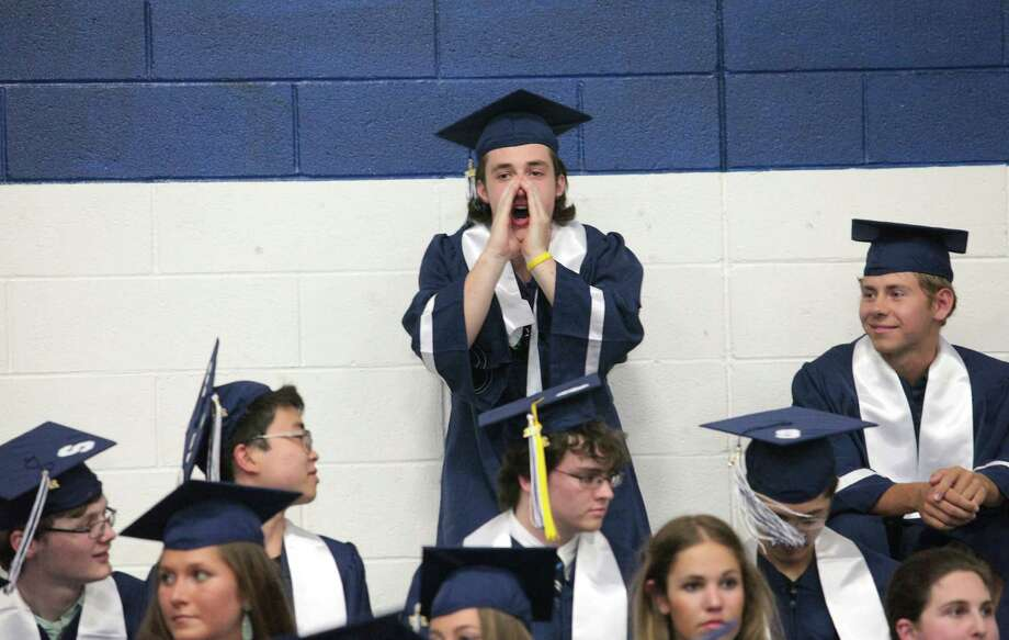 Staples High School graduate Kyle Hackett cheers on classmates during commencement exercises in Westport, Conn. on Thursday, June 18, 2015. Photo: BK Angeletti, For Hearst Connecticut Media / Connecticut Post freelance B.K. Angeletti