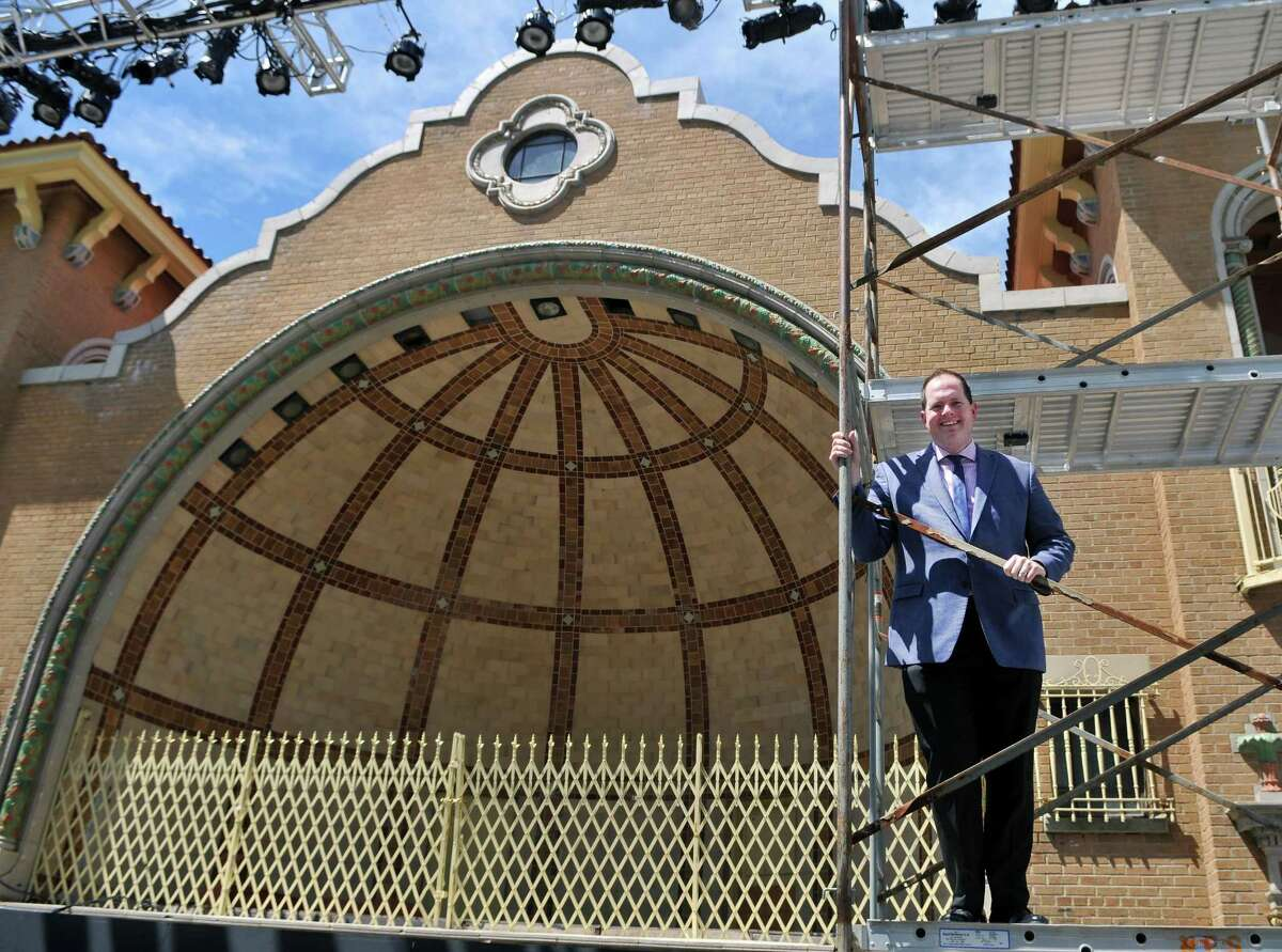 """Owen Smith, producing artistic director of Playhouse Stage Company, seen in front of the stage at the Washington Park Lakehouse, has announced that the company's mains Park Playhouse production for 2022 will be """"Head Over Heels,"""" a jukebox musical featuring songs by the 1980s all-woman American bad The Go-Go's."""