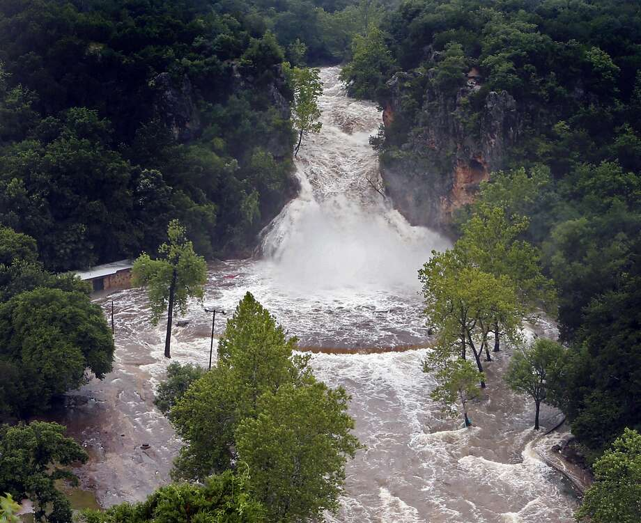 Water pours over Turner Falls and floods the park below in Davis, Okla. Tropical Depression Bill swamped Oklahoma and Arkansas and claimed at least one life since it came ashore. Photo: Steve Sisney, Associated Press