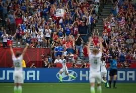 United States' Abby Wambach, center, celebrates her goal against Nigeria during the first half of a match at the FIFA Women's World Cup soccer tournament in Vancouver, British Columbia, Canada, Tuesday June 16, 2015. (Darryl Dyck/The Canadian Press via AP)
