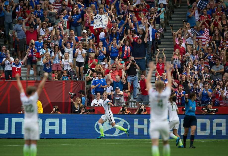 U.S.A.'s Abby Wambach (center) celebrates her goal against Nigeria during the first half of a match at the FIFA Women's World Cup soccer tournament in Vancouver, British Columbia. Photo: Darryl Dyck, Associated Press