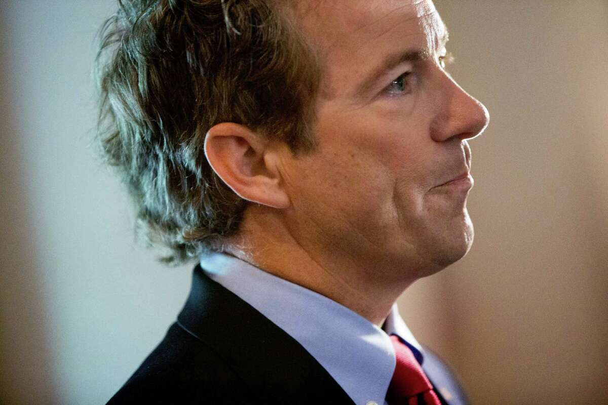 Republican presidential candidate, Sen. Rand Paul, R-Ky., waits to be introduced to speak during the Road to Majority 2015 convention in Washington, Thursday, June 18, 2015. (AP Photo/Andrew Harnik)