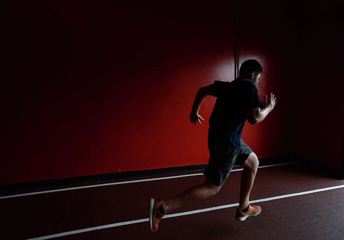 Bronson McClelland, 13, sprints down the track during strength training at the Parisi Speed school of Beaumont. Instructor Brittney O'Pry is helping young athletes of all ages and abilities the opportunity to increase their ability through a combination of strength and speed training sessions. Photo taken Thursday, June 18, 2015 Kim Brent/The Enterprise