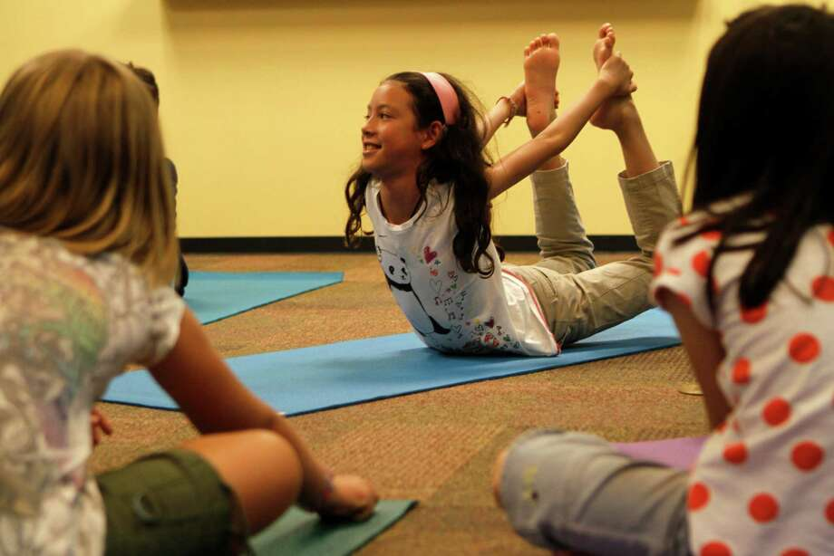 Yoga masters tell students that their yoga practice will evolve as their understanding and technique improves. ( Yasmeen Smalley / Houston Chronicle ) Photo: Yasmeen Smalley, Staff / Houston Chronicle