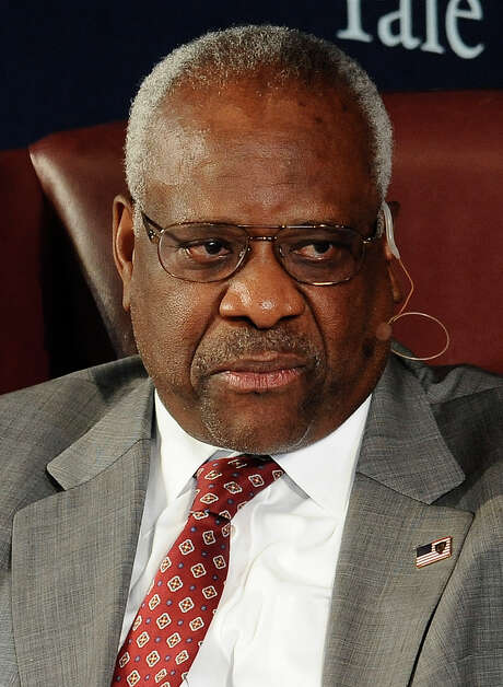 FILE - In this Oct. 25, 2014 file photo, Supreme Court justice Clarence Thomas sits for a conversation at Yale University in New Haven, Conn.  Thomas has taken unusual steps in calling attention to crime victims as the Supreme Court rules in two death-penalty cases. In one case, Thomas dissented from a 5-4 opinion that barred Louisiana from executing Kevan Brumfield, a convicted killer who is mentally disabled. Thomas included a picture of the crime victim at the end of his dissent and even referred to a video of the killer's confession that was posted on the Supreme Court's web site. (AP Photo/Jessica Hill, File) Photo: Jessica Hill, FRE / FR125654 AP