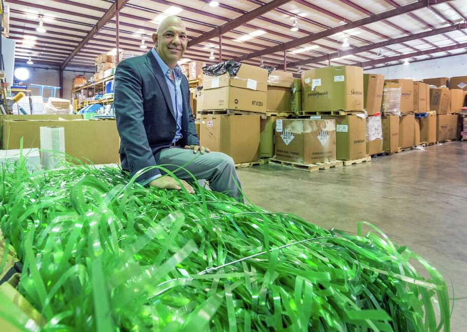 Above: Rick Perez founded Avangard Innovative, which find uses for materials that often are thrown away, such as plastic strapping. Below: High-density polyethylene chips are ready for reuse. Photo: Craig Hartley, Freelance / Copyright: Craig H. Hartley