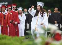 Class President Veronica Ma cheers during the 2015 New Canaan graduation ceremony at New Canaan High School's Dunning Stadium in New Canaan, Conn. Thursday, June 18, 2015.