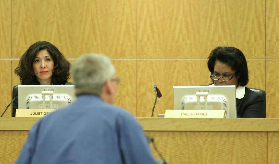 HISD board members Juliet Stipeche and Paula Harris during an HISD board meeting June 18, 2015. Photo: Jon Shapley, Houston Chronicle / © 2015 Houston Chronicle