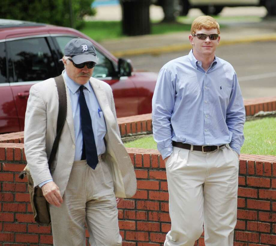 Former University of Mississippi student Graeme Phillip Harris, right, with his attorney David Hill, enter federal court, where Harris pleaded guilty to a charge of using a threat of force to intimidate African-American students and employees. Photo: Bruce Newman, MBO / Oxford Eagle