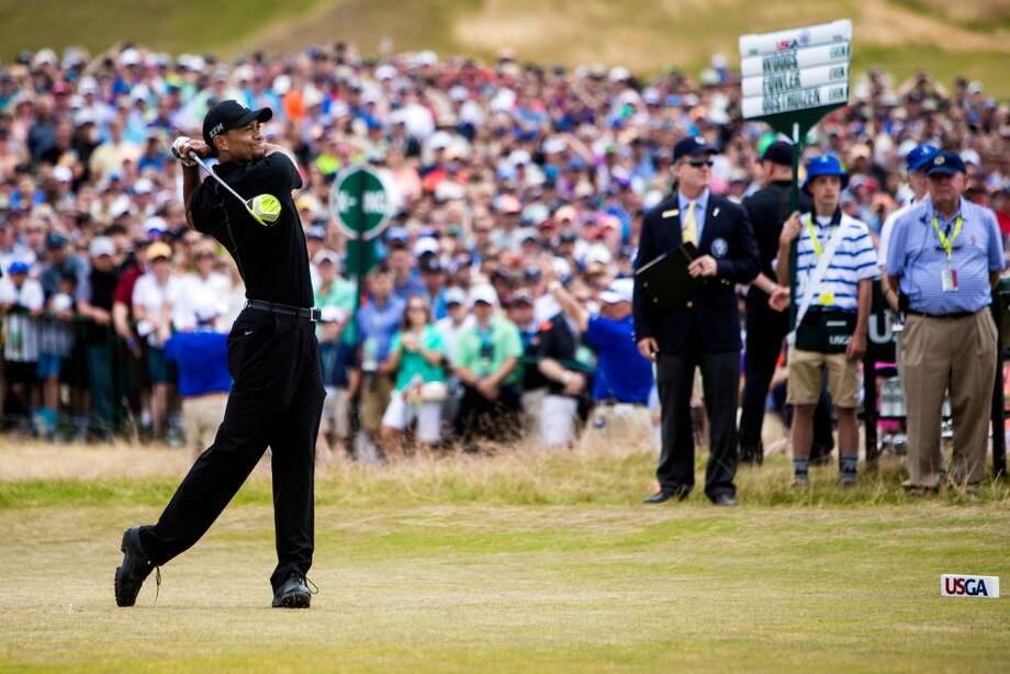 Tiger Woods tees off on the first day of the 115th U.S. Open golf tournament, photographed Thursday, June 18, 2015, at Chambers Bay in University Place, Washington. The tournament continues through Sunday. (Jordan Stead, seattlepi.com) Photo: JORDAN STEAD, SEATTLEPI.COM