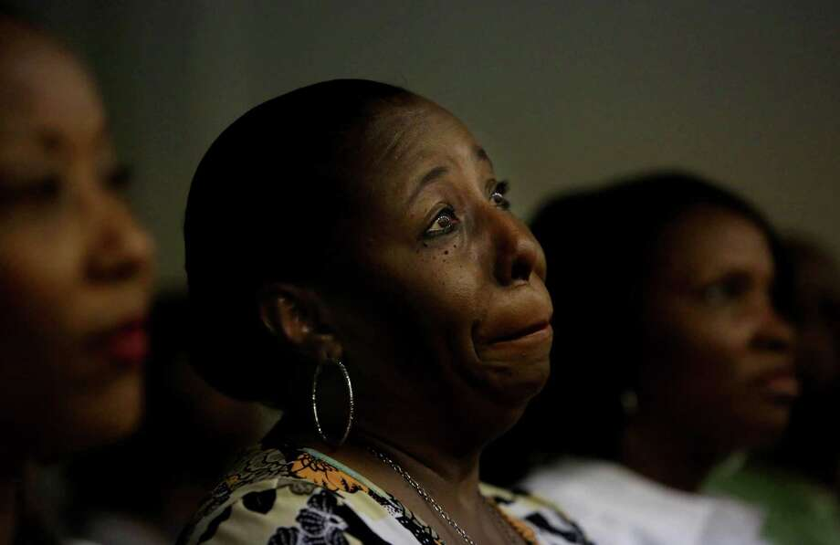 Stacey Dawson, Cassandra Warren, and Norlisa Banks, all church members, at a special prayer vigil held in St. Paul African Methodist Episcopal Church Thursday, June 18, 2015, in Houston. Photo: Gary Coronado, Houston Chronicle / © 2015 Houston Chronicle