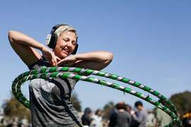 Dolores Park reopened Thursday and held a park-sponsored silent disco.  Kim Eitze can be seen hula hooping while listening to some music.