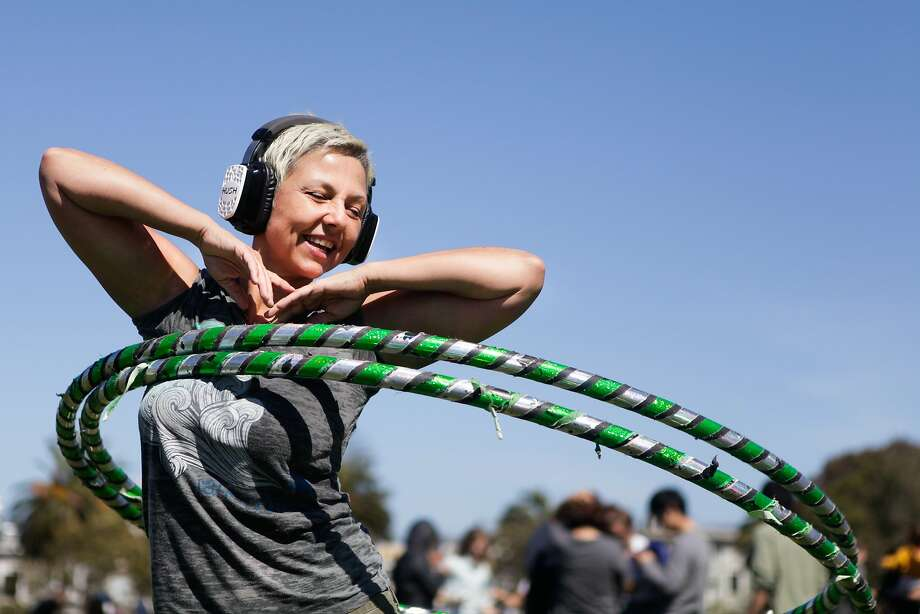 Dolores Park reopened Thursday and held a park-sponsored silent disco.  Kim Eitze can be seen hula hooping while listening to some music. Photo: Cameron Robert, The Chronicle