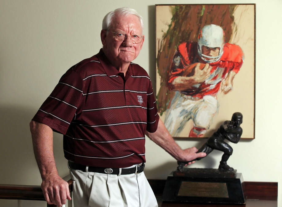 In 2013, John David Crow poses with the Heisman Trophy he won as a two-way player in 1957. Photo: Edward A. Ornelas, Staff / © 2013 San Antonio Express-News